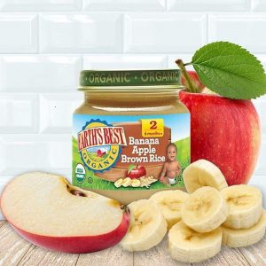 A bottle of Earth`s Best Organic Baby Food with sliced apple and banana