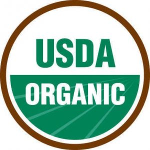 The round Usda Organic seal with green field.