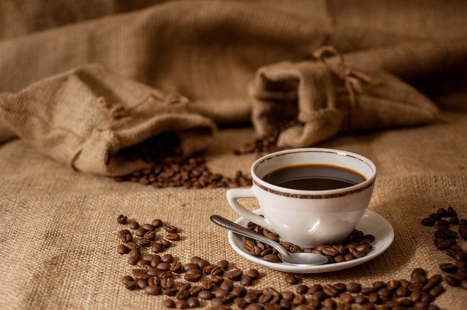 Coffee with bags of coffee beans