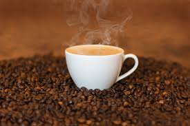 Steaming coffee with coffee beans. Consumers want non-GMO coffee.