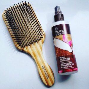 Instagram post @desert_essence of heat protector spray and brush