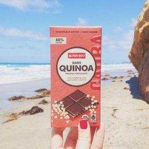 Alter Eco Dark Quinoa Chocolate bar with beach background