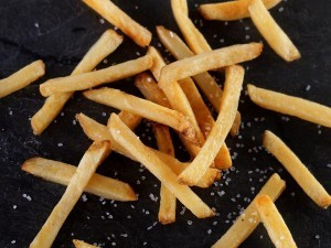 yukon select fries on black background