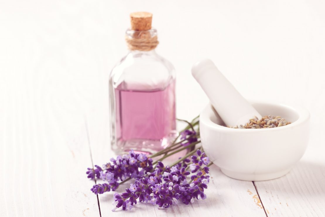 Lavender oil and lavender flowers used for aromatherapy