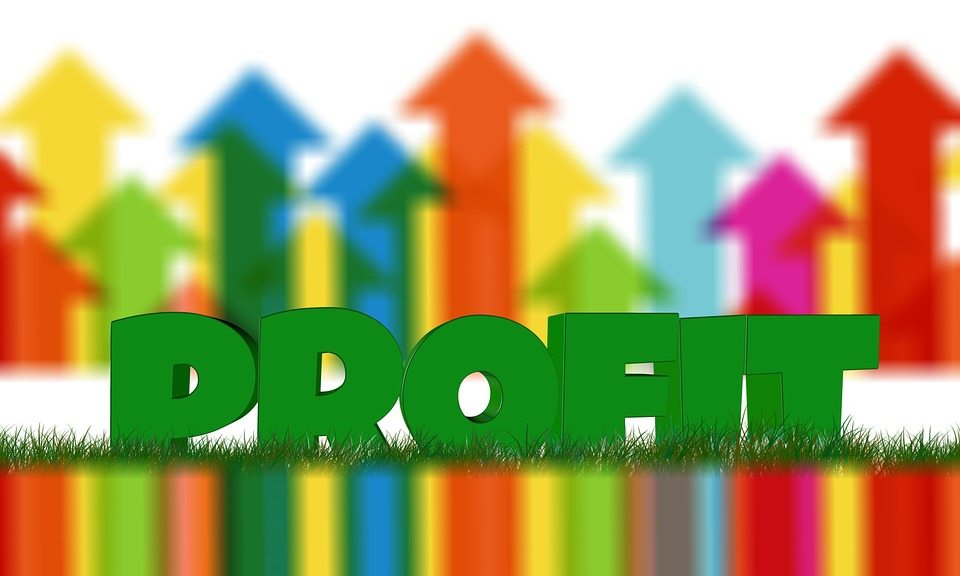 Arrows pointing up and green word profit. Selling candy's a viable option to make extra income.