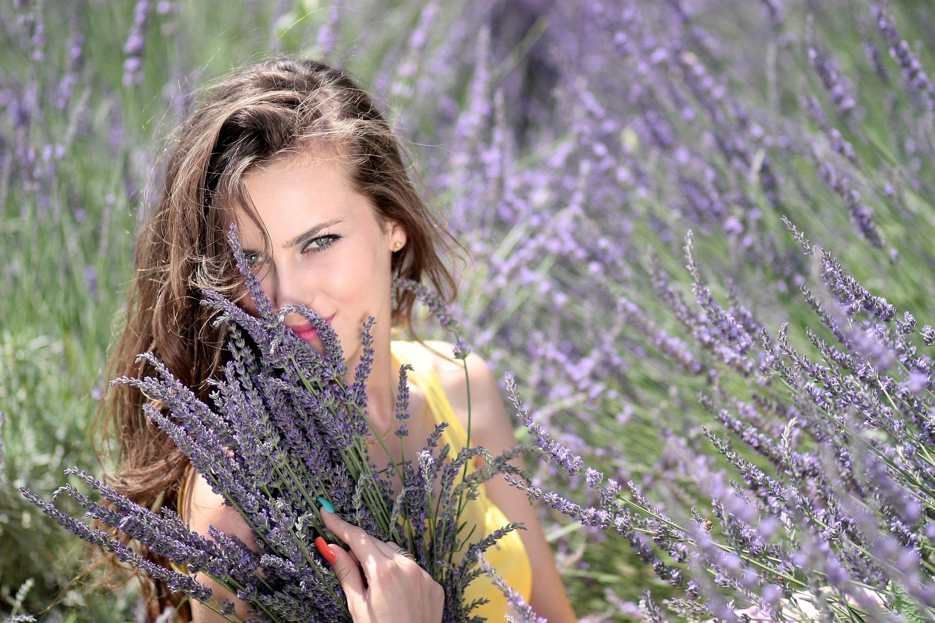 Woman in field of lavender flowers