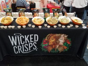 Row of Wicked Crisps bowls and bags at their Expo West 2018 booth