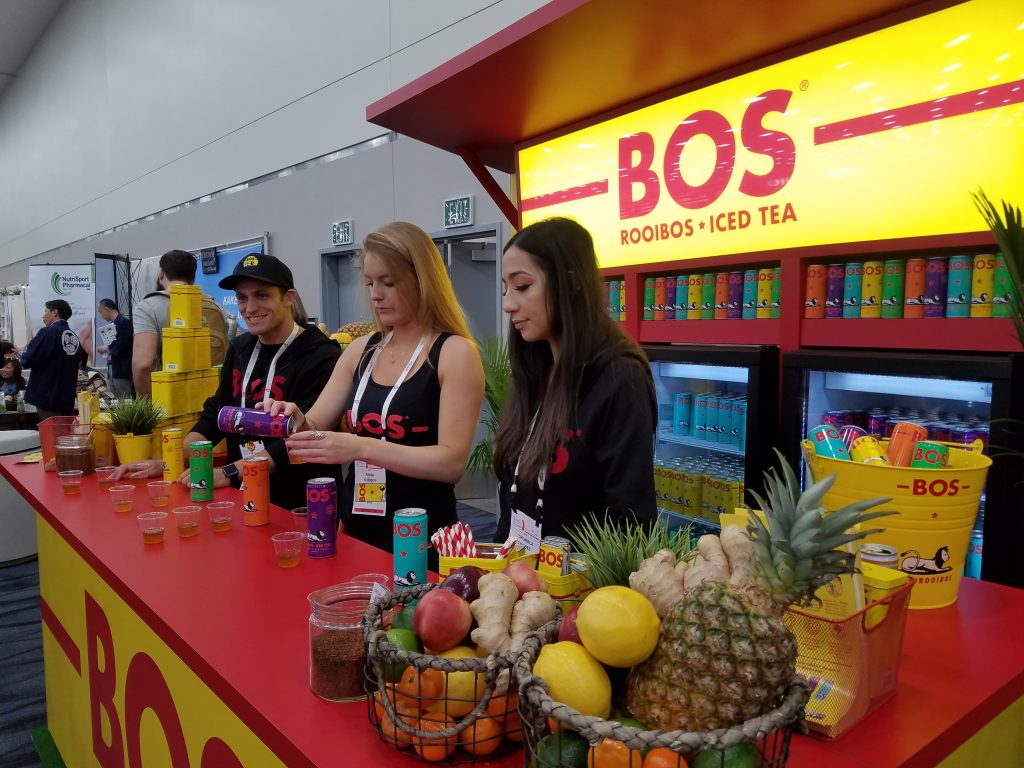 Veronica Chaidez (right) and Erika Kubisch (center) (with third representative) serving BOS samples at the Natural Products Expo West 2018 booth