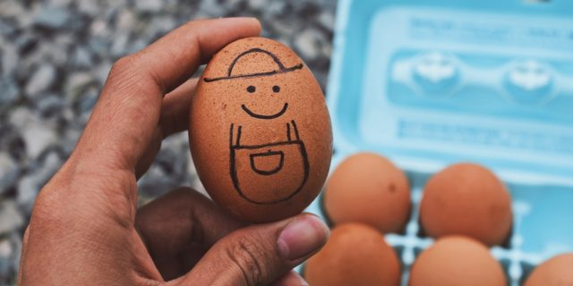Egg with funny face drawn on it.