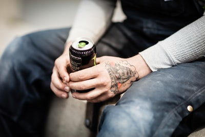 Man holding energy drink.