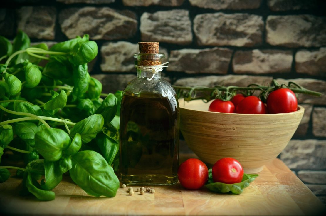 Basil with olive oil and tomatoes