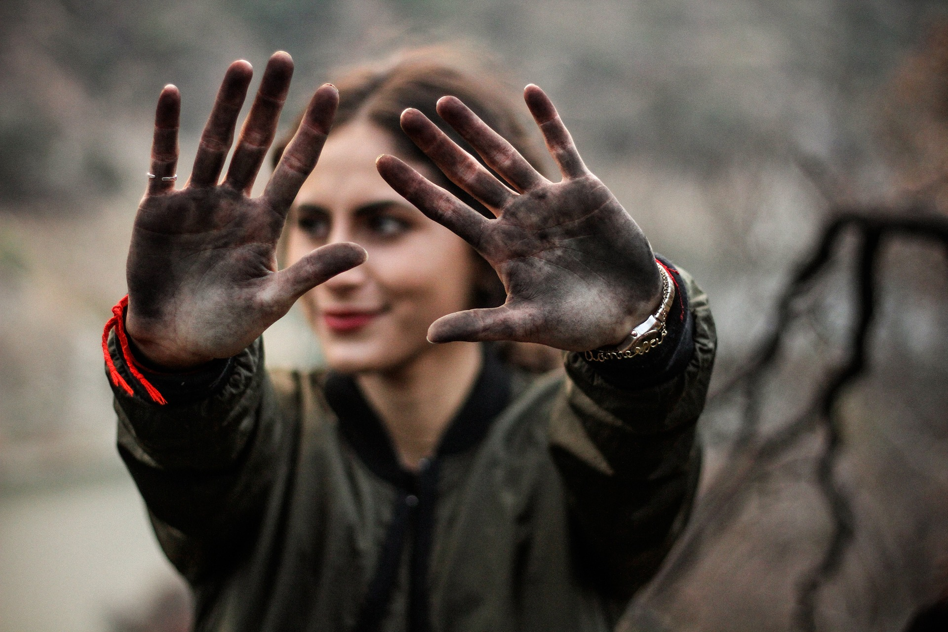 Woman with dirty hands