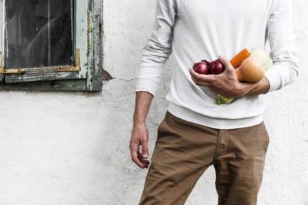 guy holding fruit