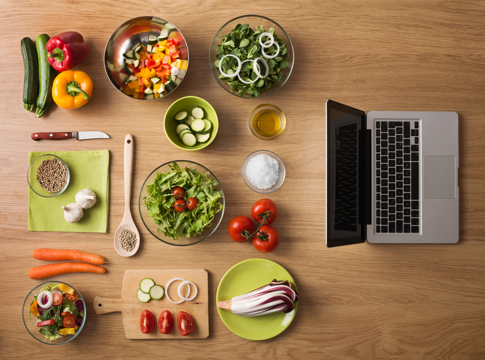 vegetables next to a laptop. what wholesale vegan food should I carry in my online store?