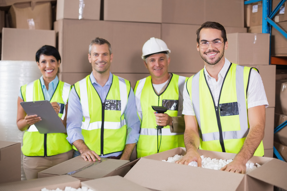 Dropshipping warehouse workers packing boxes. Find a homeopathic medicine supplier.