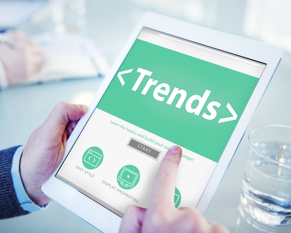 the word trends displayed on a tablet. Article lists top dropshipping trends for the year