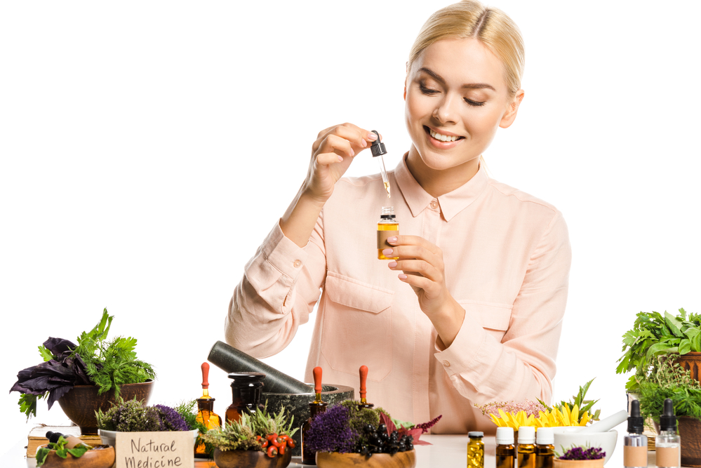what is homeopathic medicine? a woman making a homeopathic tincture.
