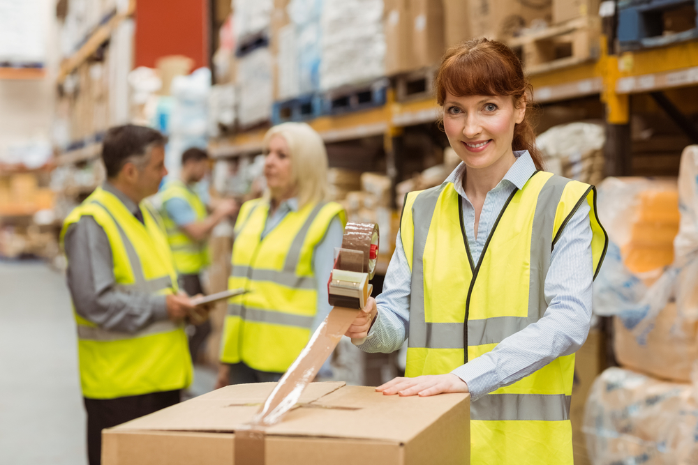 dropshipping supplier woman working in warehouse packing boxes