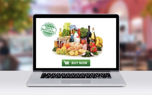 laptop displaying groceries and a buy now button