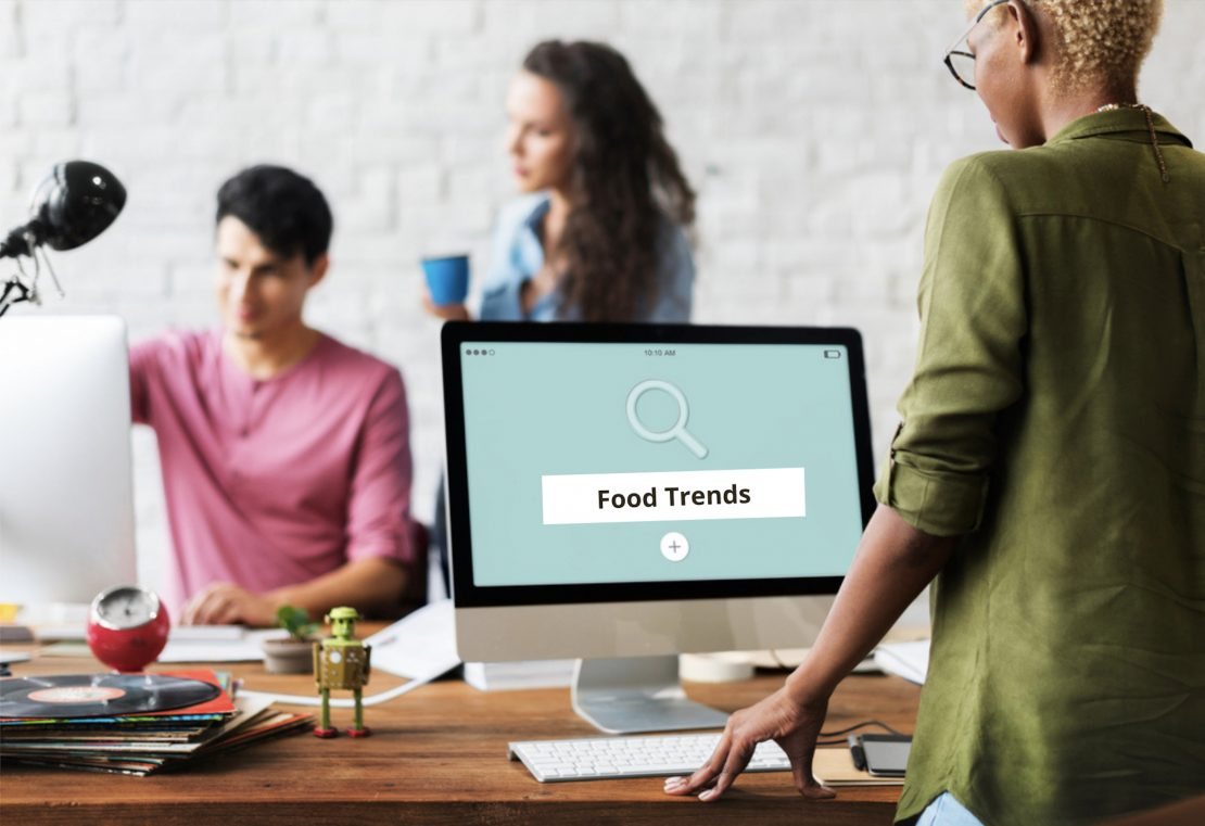 woman on laptop searching the word food trends.