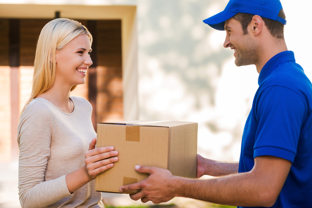 a man delivering a dropshipping order to a woman at home