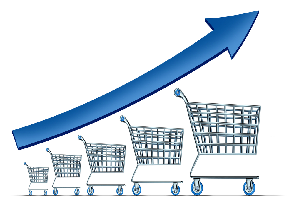 an arrow going up over shopping carts to illustrate increasing your average order value.