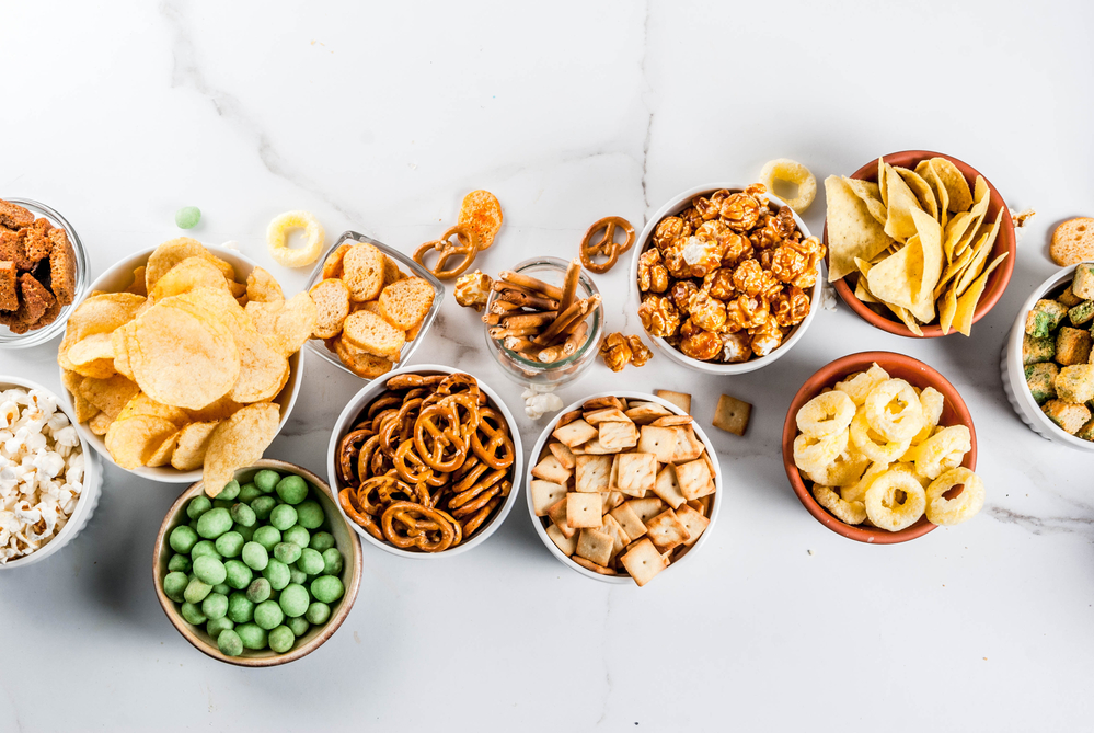 wholesale exotic snacks in bowls on a white table