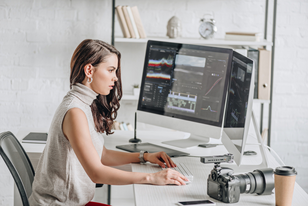 a woman using video editing equipment on her computer