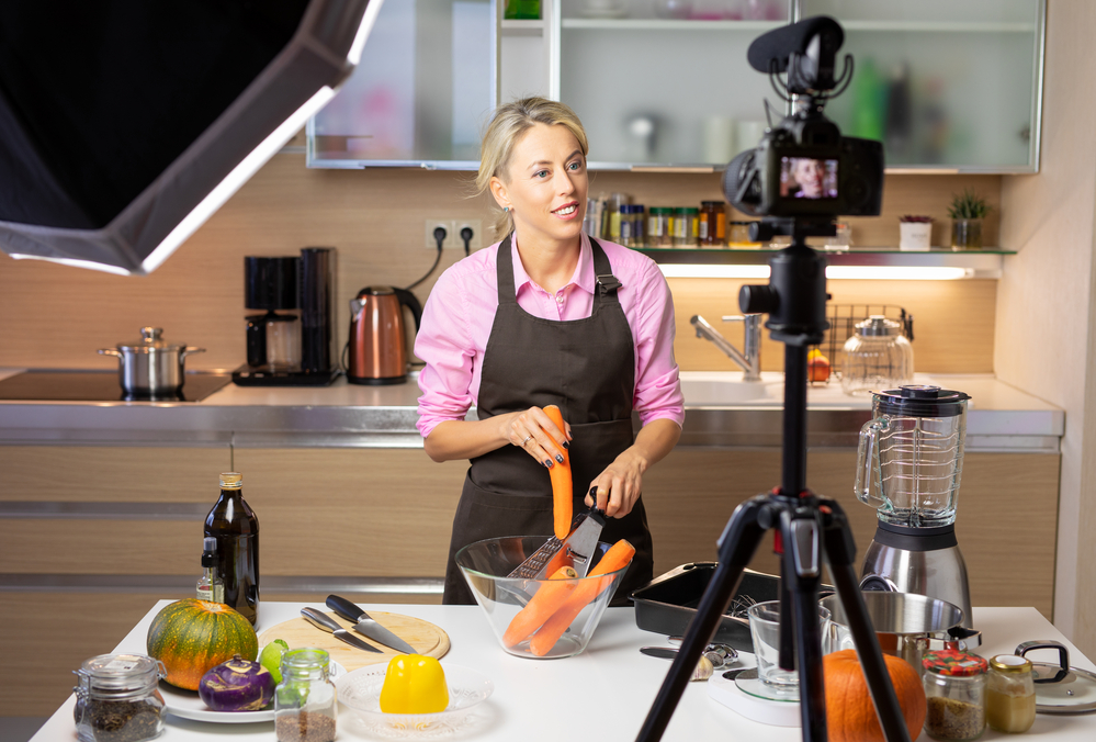 woman making a how to video ad showing a recipe in her kitchen